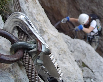 Climber on a via ferrata climbing route